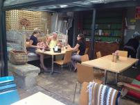 With a selection of dining tables inside, couches and benches on the porch and beanbags and barrels amongst the garden, evviva has a table to suit everyone- even your pooch!