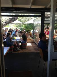 Tourists and locals alike enjoying the beautiful weather and food.