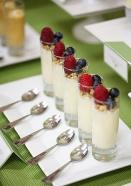 Adorable yoghurt, granola and mixed berry shooters.